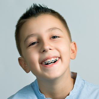 Young boy with pediatric orthodontics smiling