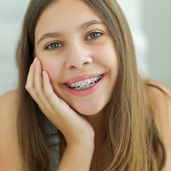 Teen with self ligating braces smiling