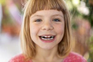 Smiling little girl with pediatric orthodontics in Holliston